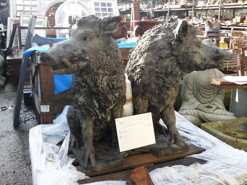 Two wild boar statues
