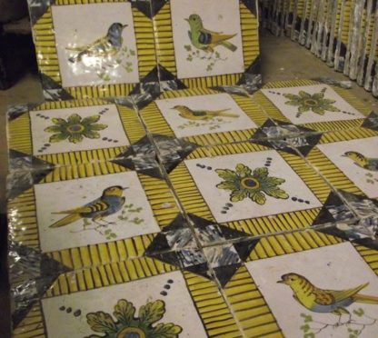 Hand painted bird and patterned tiles